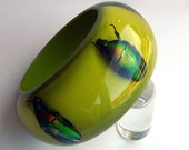 Large green lucite bangle with real insects