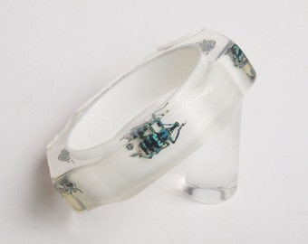 White scalloped lucite bracelet with real bugs