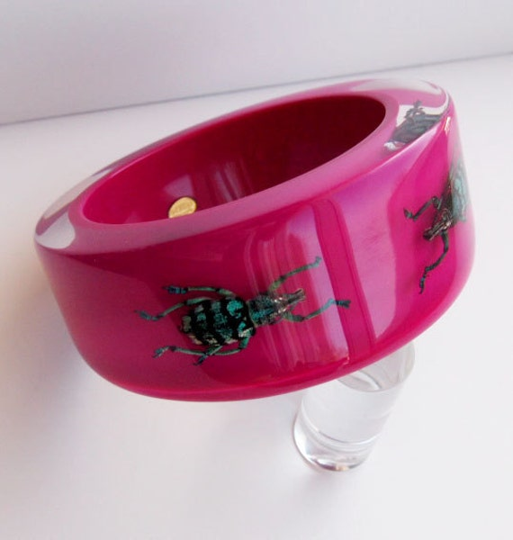 Magenta lucite bracelet with real beetles