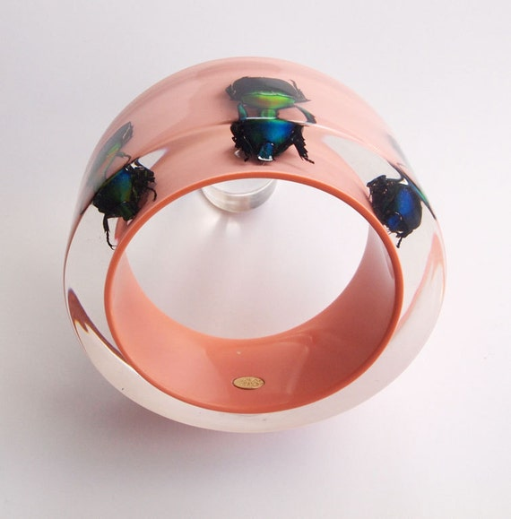 Large pink lucite bangle with three exotic real insects