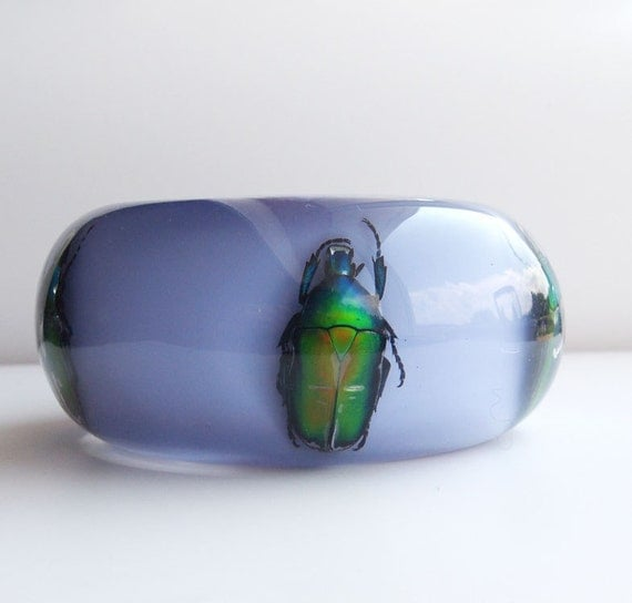 Large lavender lucite bangle with five real metallic insects