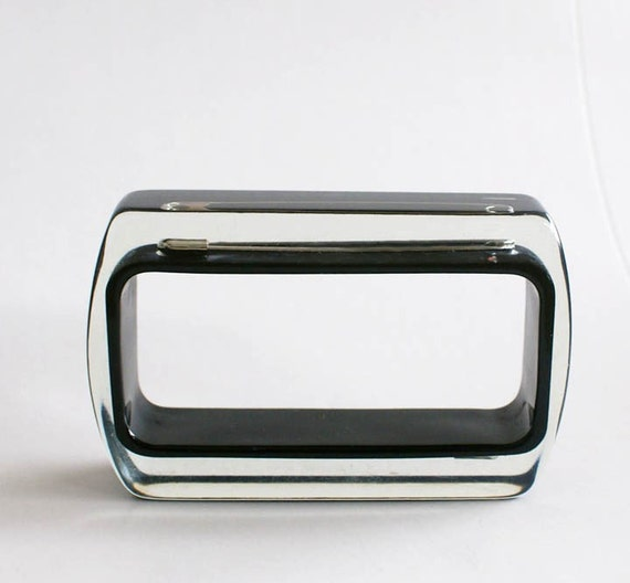 Black rectangle lucite bracelet with safety pins