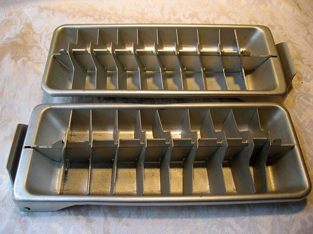 pair of vintage metal frigidaire ice cube trays. Black Bedroom Furniture Sets. Home Design Ideas