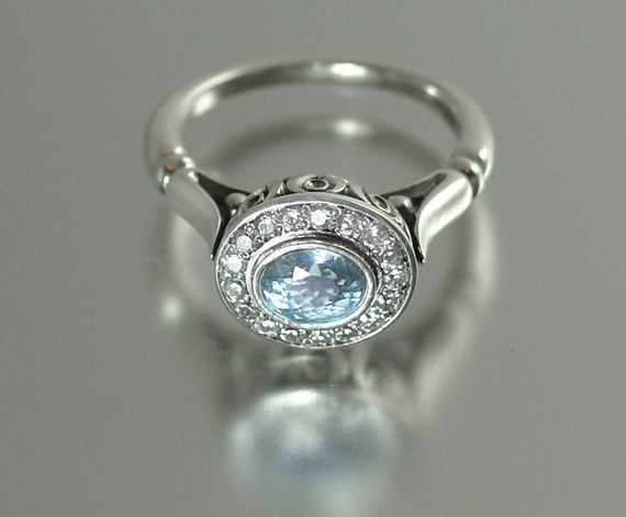 THE SECRET DELIGHT 14k gold Aquamarine engagement ring with White Sapphire halo