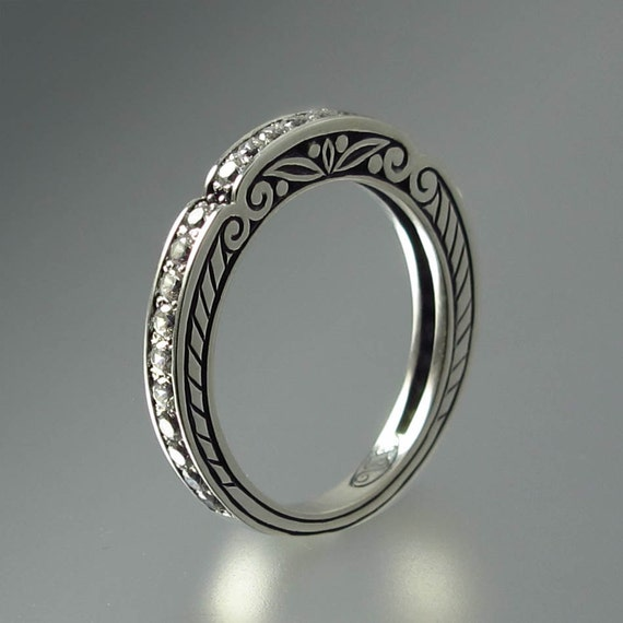 CARYATID wedding band in sterling silver with white saphires