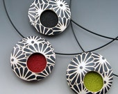Contemporary polymer clay pendant necklace in abstract black and white design on neckwire choker