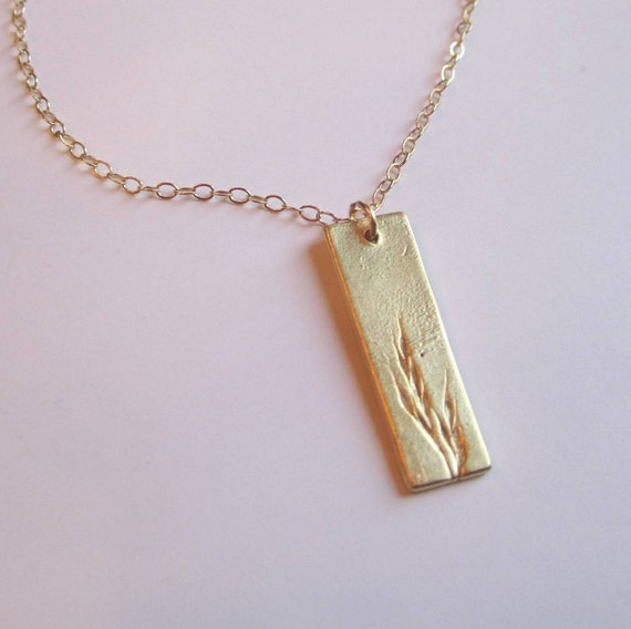 Slim rectangle with grass imprint gold vermeil pendant on gold filled chain necklace