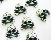Skull Cabochons with crossbones 18 pcs size 15 x 16 mm.
