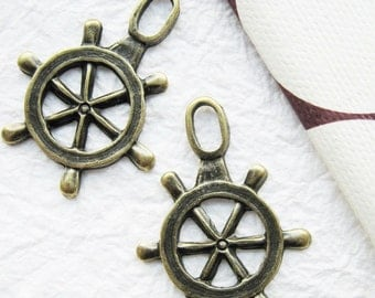 10 pcs of  tiny charms - Antique brass ship wheels charm
