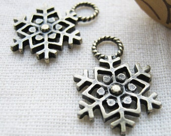 10 pcs of  tiny charms - Antique brass snowflakes charm