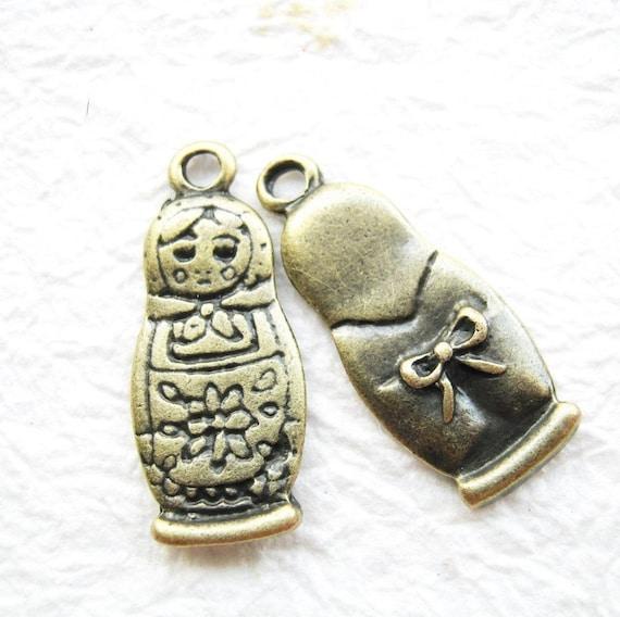 10 pcs of  tiny charms - Antique brass russian doll matryoshka charm