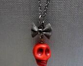 "Red Skull and Black Bow Necklace // Red Howlite Gemstone Skull // Gunmetal Bow // Halloween // 17"" Gunmetal Chain"