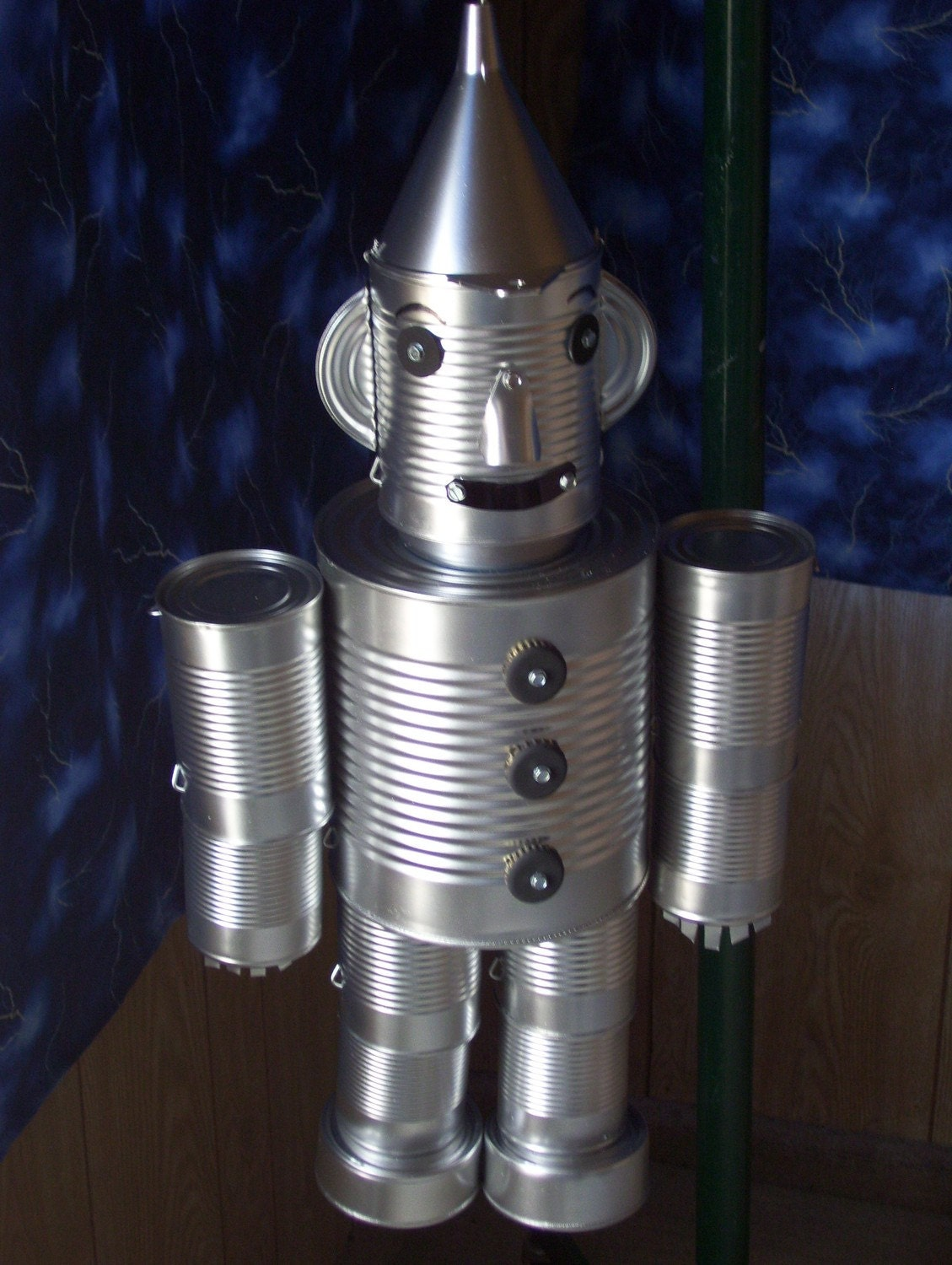 Unavailable listing on etsy for Tin man out of cans