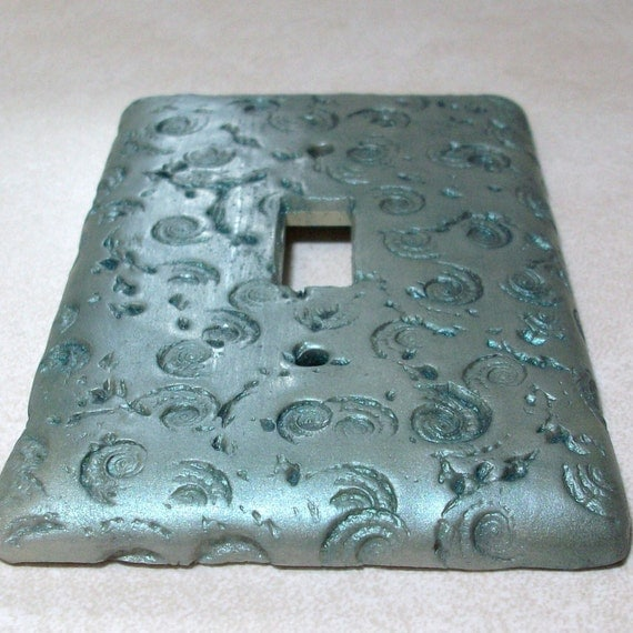 Fossils and swirls switch plate cover