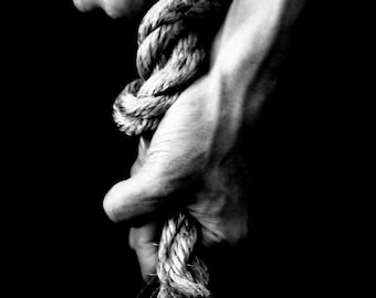 black and white photograph, fine art photography conceptual photography, female hands, rope, woman