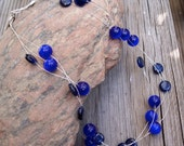 Triple strand blue bead floating necklace
