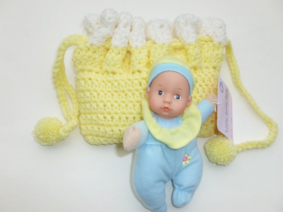 Cradle purse with doll