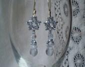 Sparkly light blue beaded star earrings
