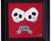 LOVE double skull art piece
