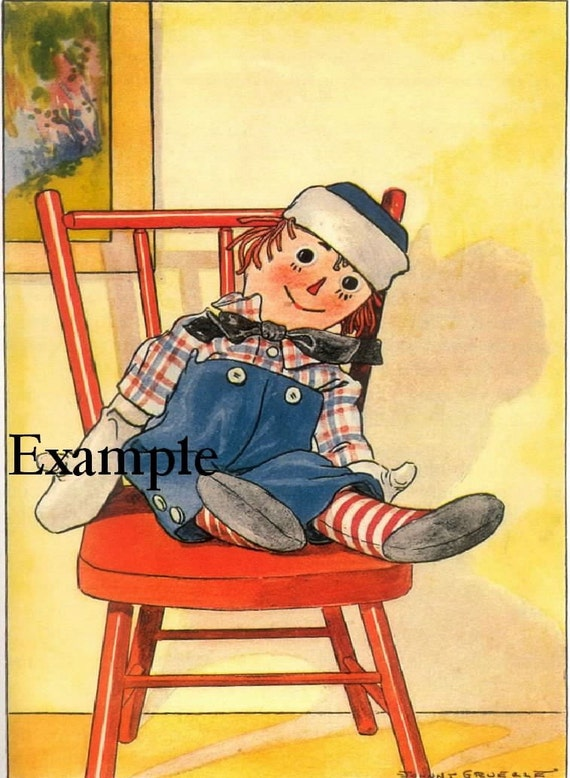 Raggedy Andy sits on a chair,two identical fabric blocks,Great room decor for  children