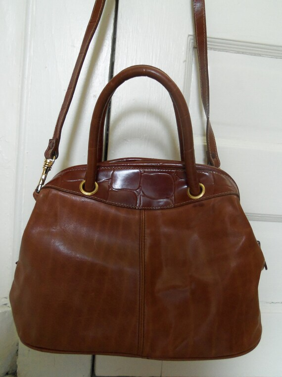 is there a doctor in the house brown leather handbag