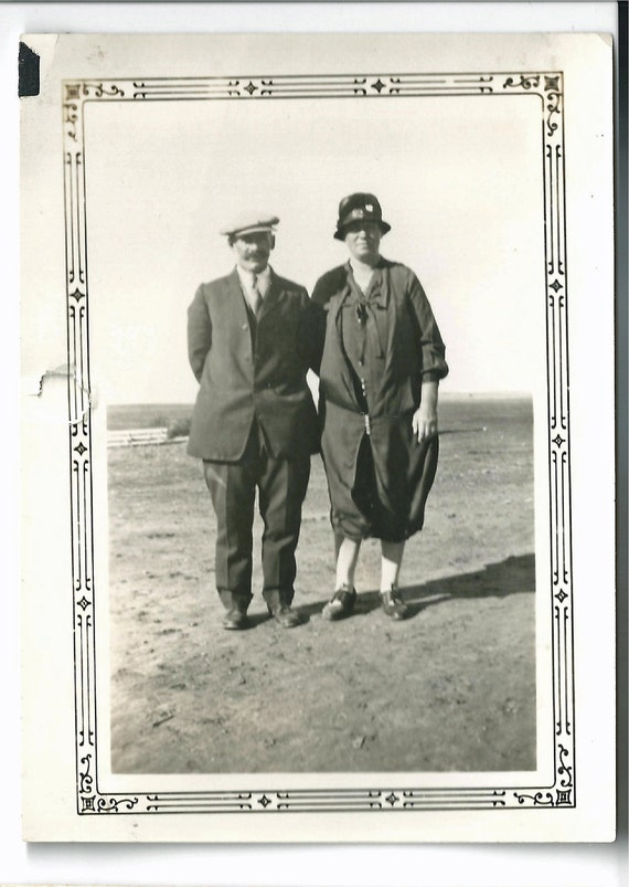 Antique snapshot photo Funny old couple on the beach German black and white ornate border