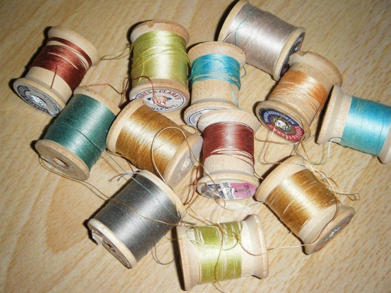 vintage wood spool threads. mix of colors.