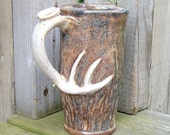 mans ceramic travel mug deer antler handle camoflauge colors with natural cork stopper 12 ounce size