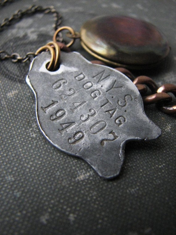 1949 . dog tag necklace .