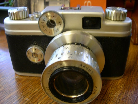 Argus C44 camera,  lenses and other accessories