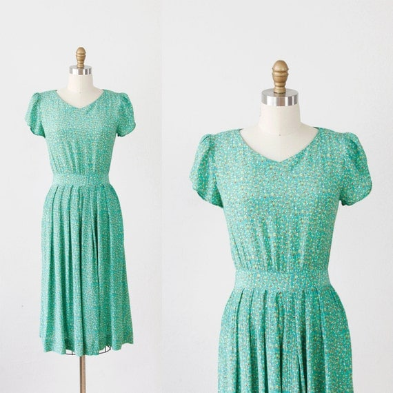 Kelly Green Dress with Colorful Speckles and Red Buttons