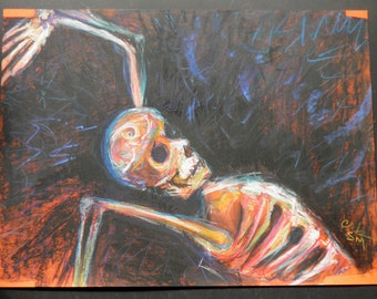 Skeleton Reclining by Fire Pastel Drawing on Orange Paper Halloween Day of the Dead