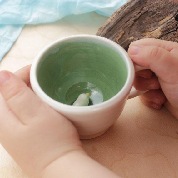 green bird hand thrown surprise mug