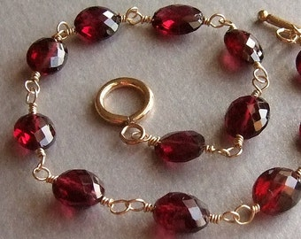 Faceted Oval Garnet Bracelet in Gold, Wire Wrapped Bracelet, Red Gemstone Bracelet