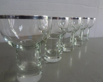 5 Uniquely shaped silver rimmed glasses