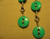 Double drop dangling green plastic button earrings wrapped with stainless steel wire silver coloured