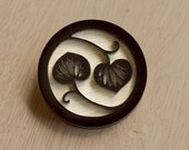 Black lily brooch