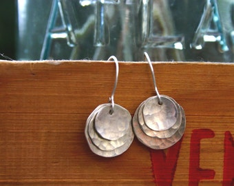 small hammered triple disc earring.