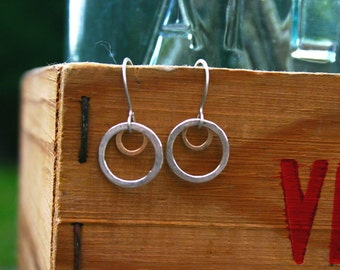 xs open and small circle mixed earrings.