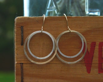 large double mixed open circle earring.
