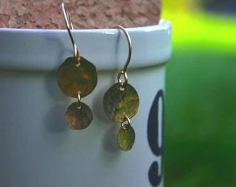 gold backward chandelier earring.