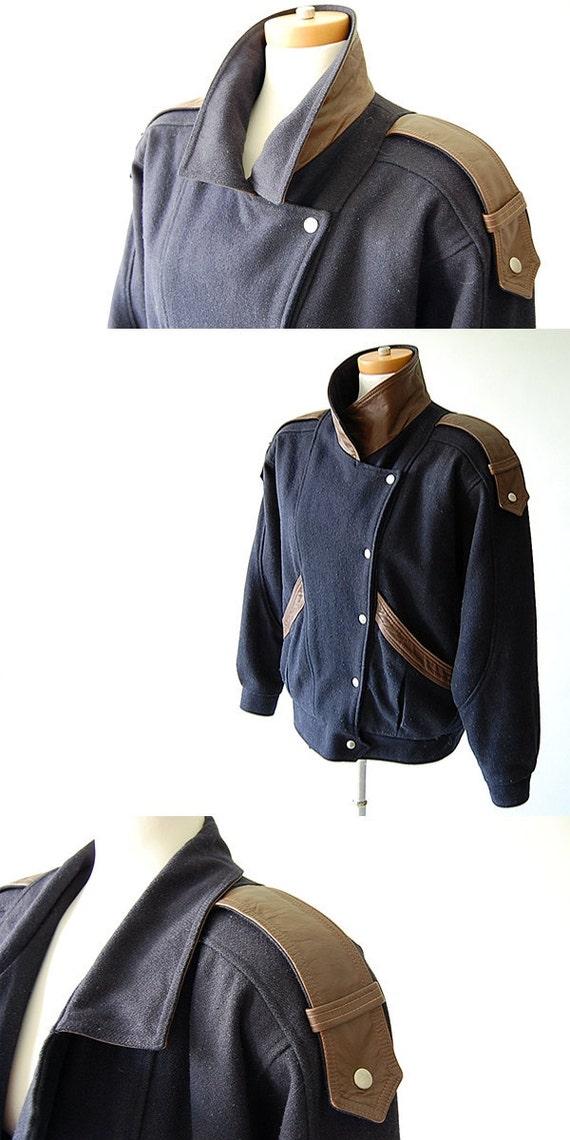 80s vintage Avant Garde Coat . Dark Blue Wool and Brown Leather . Asymmetric Closure . Epaulets . Snaps