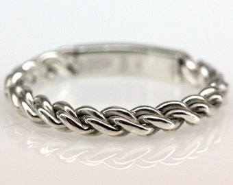 Double twist ring in sterling silver.