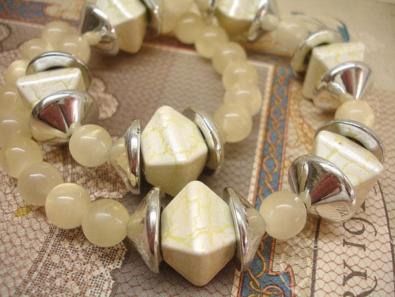 vintage beads in shades of soft yellow . large crackle bicones . lucite moonglows . bead caps