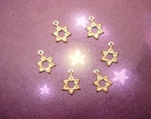 SALE---1.00---6 Tiny Star Of David Charms on Etsy