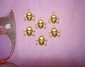 SALE Tiny Skull and Crossbone Brass Halloween Charms on Etsy x 6