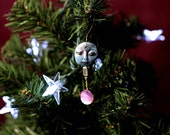 Holiday Ornament, shimmery blue face with purple shell and gem...001