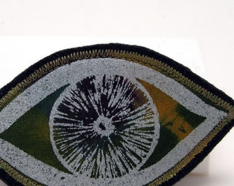 Wearable art fabric brooch pin, eye design brooch, textile brooch, screenprinted eye, green and silver, vesica piscis, protection symbol