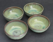 set of four small green bowls