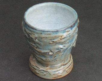 one medium sized cup